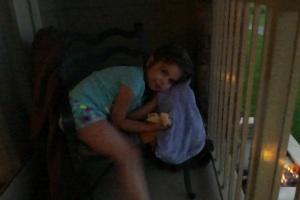 Helene curled into balcony chair