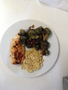 5.5 ounces skinless chicken breast, one dozen Brussels sprouts sauteed with garlic and pancetta, 1/2 cup rice pilaf = 470 calories